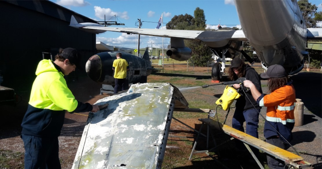 Our ACES students work on the Neptune 302 at the Parkes Airport Museum
